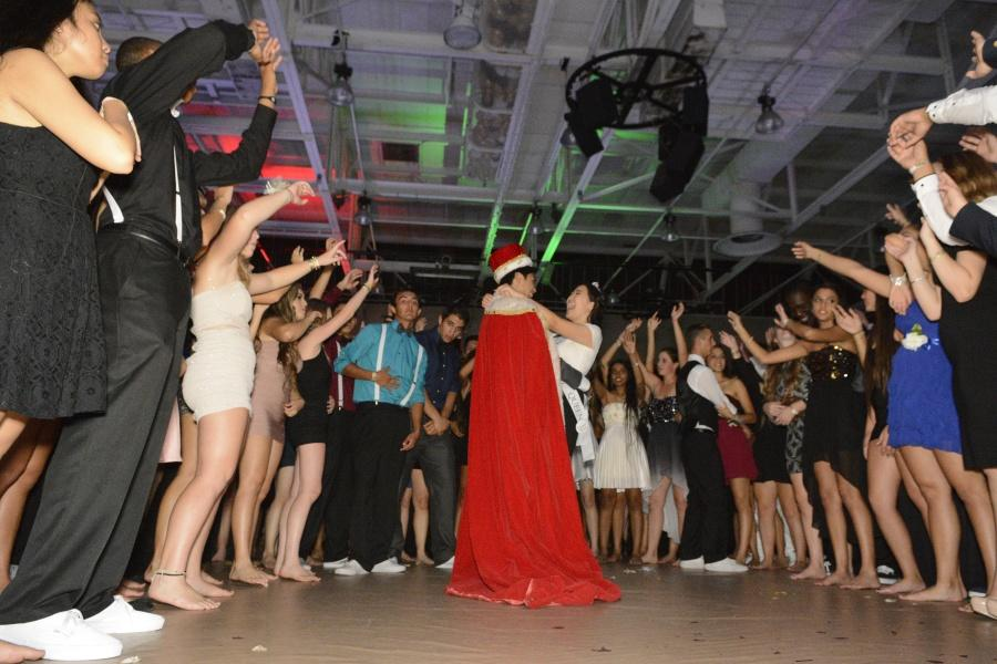 Aaron Barlin (12), Homecoming King, dances the traditional Homecoming dance with April Tsuei (12), Homecoming Queen.