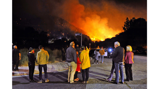 Residents watch as the Woolsey fire burns in the West Hills area of the San Fernando Valley. (Photo by Andy Holzman, CONTRIBUTING PHOTOGRAPHER)