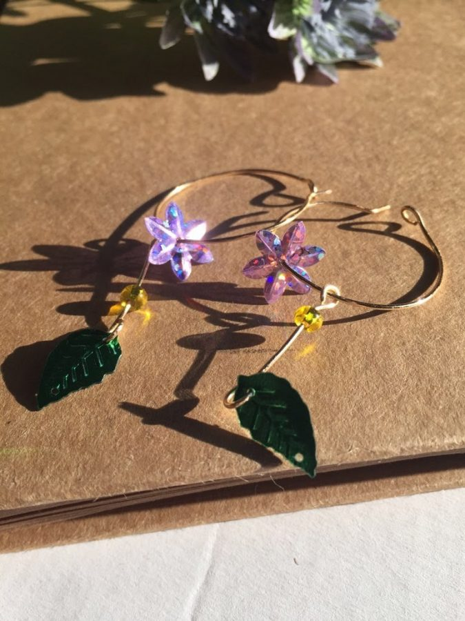 This pair of flower earrings is one of the many designs Lindsey Kim (12) creates in her freetime. Picture Courtesy of Lindsey Kim.