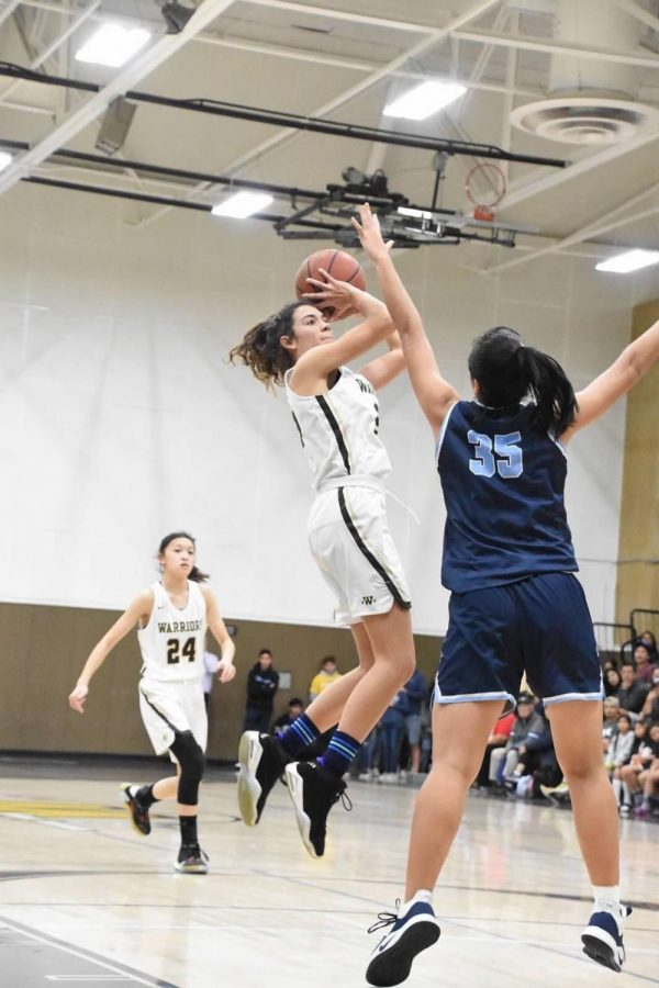During+the+third+quarter+of+the+Girls%27+Varsity+Basketball+game%2C+Jaden+Sanderson+%2811%29+scored+a+remarkable+point%2C+helping+her+team+maintain+a+lead+against+North.+Picture+Courtesy+of+Jordyn+Morimoto.