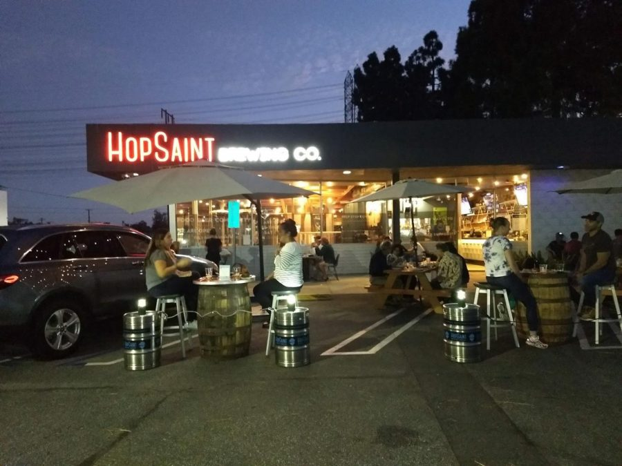 Customers+enjoy+dinner+at+HopSaint+Brewing+Company%E2%80%99s+socially-distanced+outdoor+patio.