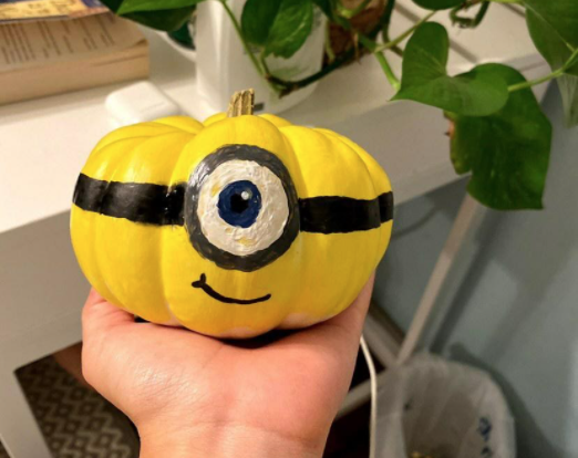 """As Halloween creeps closer and closer, Kate Phan (10) and Molly Paulson (10) paint minion designs on mini pumpkins. Despite the restrictions on traditional Halloween gatherings, Phan expressed, """"Surprisingly I actually love quarantine. I don"""