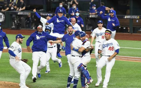 The Los Angeles Dodgers swarm the field on Tuesday, October 27, following pitcher Julio Urías's final strikeout of the ninth inning. Overjoyed, the Dodgers celebrate their hard-earned win as Game 6 of the World Series comes to a close.