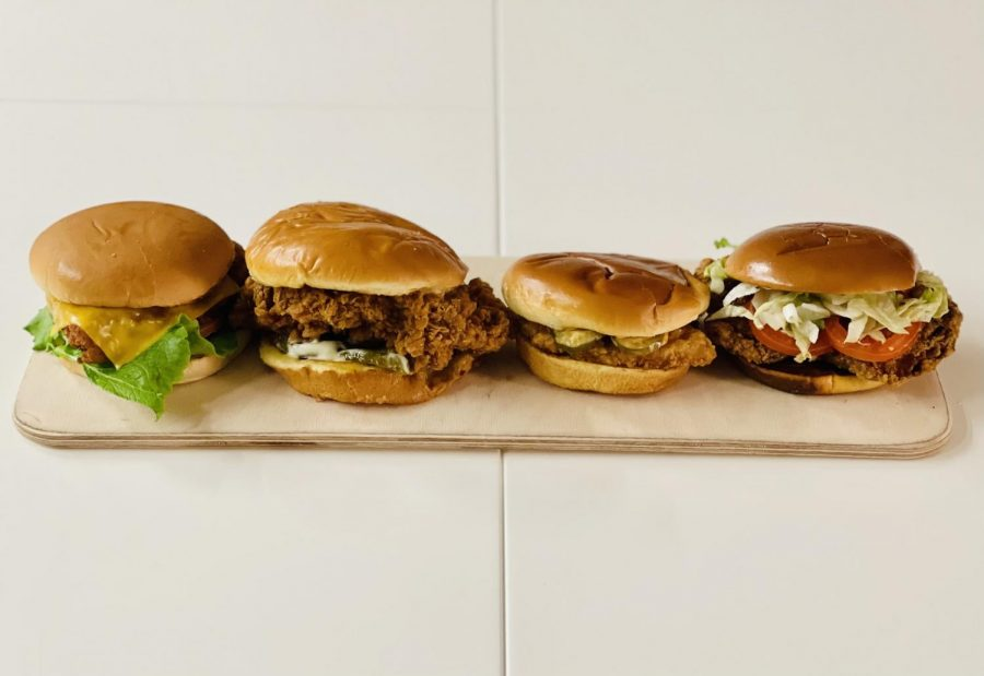 The fried chicken sandwich wars heat up as contenders release new sandwiches on their menus. From left to right: Chick-Fil-A®️ Deluxe Sandwich, Popeyes Chicken Sandwich, Jack in the Box's Cluck Sandwich, McDonald's Buttermilk Crispy Chicken Sandwich.