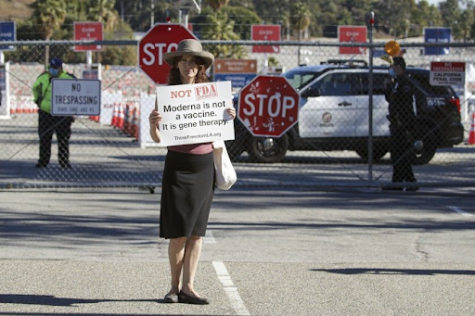 An anti-vax protester criticizes the Moderna COVID-19 vaccine at the Dodger Stadium vaccination site. She is one of many demonstrators who participated in a protest on the afternoon of January 30, assembled by the organization Shop Mask Free Los Angeles. Photo courtesy of The Los Angeles Times.
