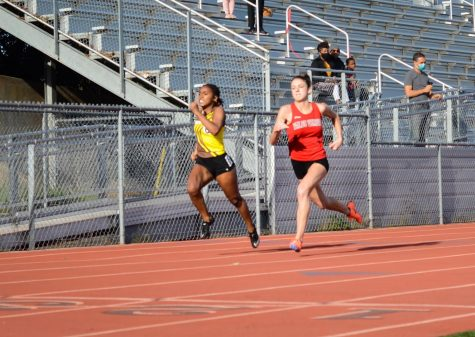 "Seconds away from the finish line, Amor Jones (11) gives it her all in a battle for first against the Palos Verdes sprinter in the varsity girls' 200m race. On Saturday, March 20th, West High Track & Field kicked off their season with a friendly dual meet against Palos Verdes High School. Jones described her feelings about returning to the track for races once again: ""I can admit I was nervous, but me being nervous I feel made me more prepared... while I was running it felt like I was floating in a way."""