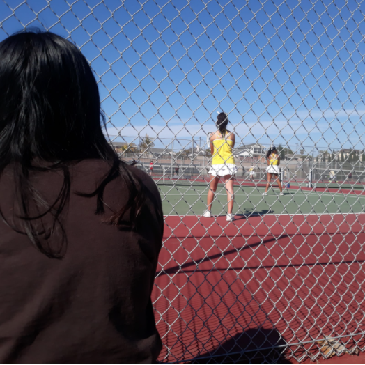 At tennis' first League match of the season, the fence that was once engulfed by families and fans was replaced by a handful of supportive parents and teammates in response to the recent TUSD spectator guidelines.