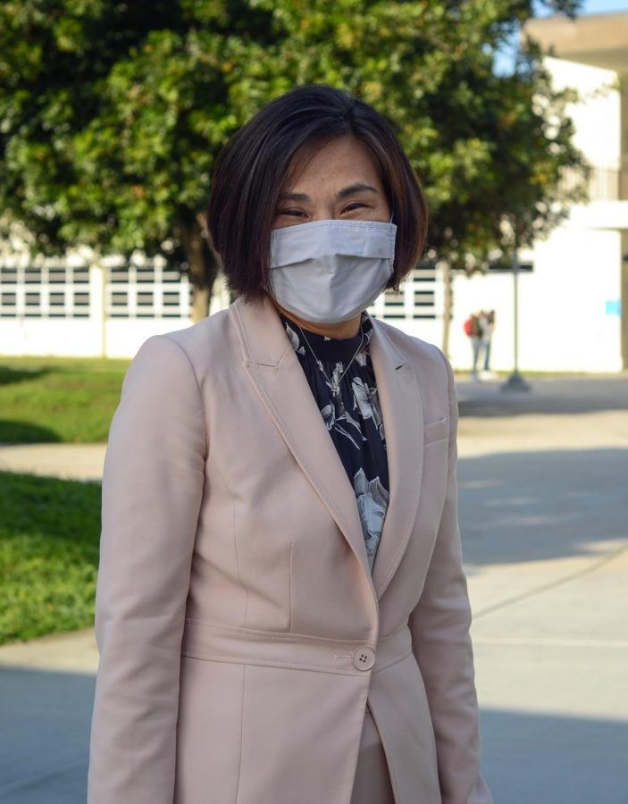 Looking beautiful as ever, West's Principal Mrs. Murata color-coordinates her mask and outfit to achieve a simple yet fresh look.
