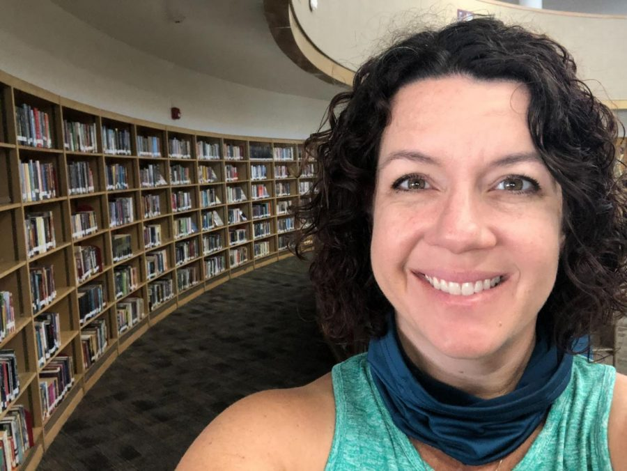The seemingly endless line of shelves in West High's library are filled with books of all different shapes, sizes, and genres. As the West High librarian, Mrs. Puccio's passion for reading is shown through the multitude of books she provides for students. Photo courtesy of Mrs. Puccio.