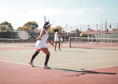 """For the West High Girls' Tennis Team, First Serve was an event filled to the brim with suspenseful games. During their first set, Sarah Han (11) and Jasmin Cuaresma (11) played to a tiebreaker against Rosemead. """"It was super stressful, but we were still proud of ourselves since we put up a fight,"""" Cuaresma said."""
