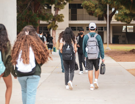 An early start, freshman students make their way to their first periods in West High's Building Five, ready for learning. Finding their classes is a breeze after already having a few days of instruction.