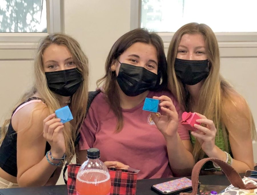 At their first meeting, Sending Love Club members show off their hand-crafted heart boxes as they prepare for a year full of heart shaped crafts. Photo courtesy of Allison Tsai (11).