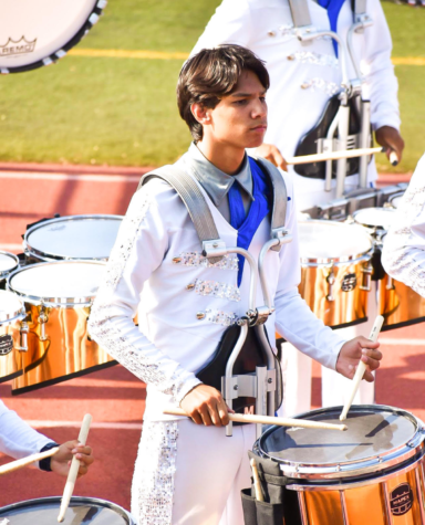 Kaiawe Miyasato (12) can almost always be found with a pair of drumsticks and a set of drums. Though he's been playing since childhood, Miyasato gained a love for performing through his experiences at West High, and hopes to continue performing the drums after graduation. Photo Courtesy of Kaiawe Miyasato (12).