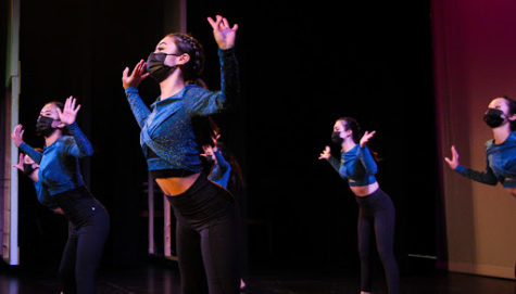 """Misa Cohen's (11) choreographed dance number """"SOS"""", was performed by Intermediate dancers. In a show stopping blue top and black bottoms, the jazz piece was upbeat and impressive. In her preparation, Cohen admits, """"It was definitely difficult to choose a song I liked but also a song that was easy to choreograph to."""" Photo by Kaila Uyemura (12)."""